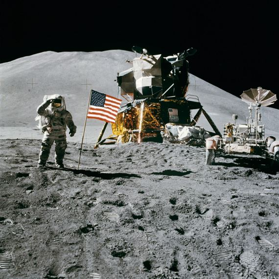 Apollo 15 Lunar Module Pilot James Irwin salutes the U.S. flag.